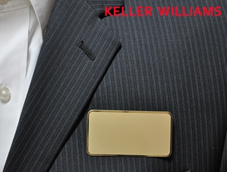 KW logo on frosted gold rectangle
