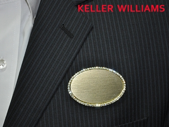 KW logo on gold bling oval