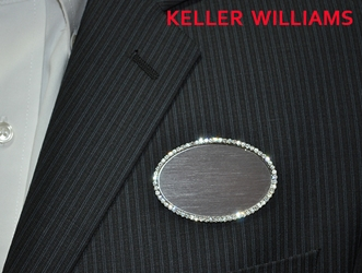 KW logo on silver bling oval